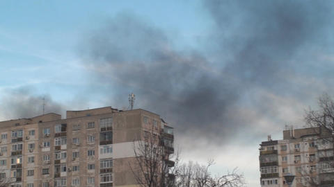 Apartment Blocks On Fire Smoke Rising Pan-Shot Footage
