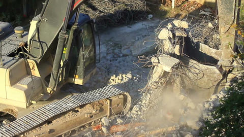 Crawler excavator lifting up scrap rebars Footage