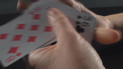 Hand Shuffling Cards Side-Shot Footage