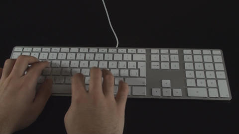 Hand Typing The End On A White Keyboard Point Of V stock footage