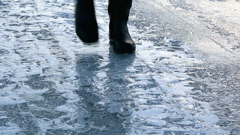 Bubbles crackling when person walking on ice Live Action