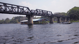 Raft Passing Under The Bridge Over The River Kwai stock footage