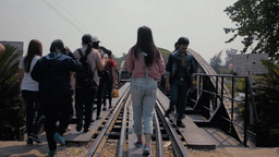 Tourists Crossing The Bridge Over The River Kwai I stock footage