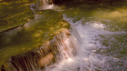 Water Flowing Over a Small Cascade Waterfall Footage