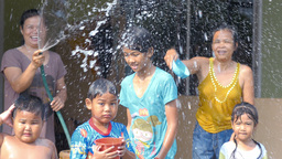Thai Family Enjoying A Water Fight During The Annu stock footage