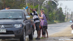 Thai Family Blessing A Passing Truck With Water Du stock footage
