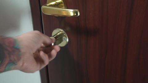 Unlocking Door Medium-Shot Footage