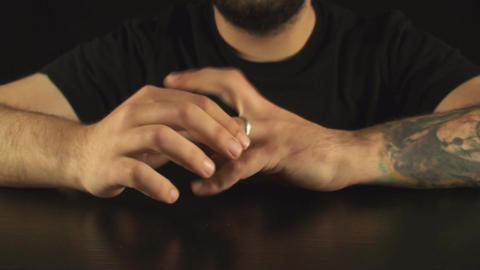 Young Male Removing A Ring On His Finger Front-Sho Footage