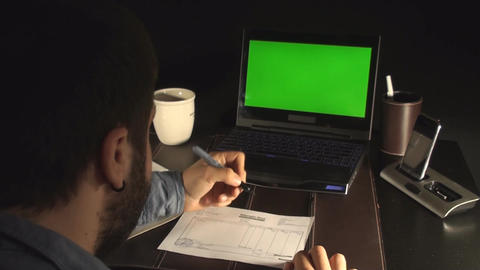 Office Setup Laptop With Green Screen And A Young  stock footage