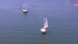 Sailboat And Motorboat Toward Camera Long Beach CA stock footage