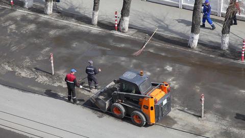Road workers clean the street Footage