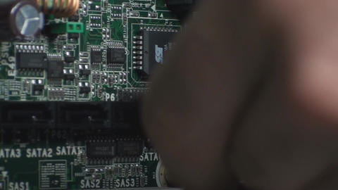 Man Plugs In A SATA Cable Into A Motherboard Side- Footage