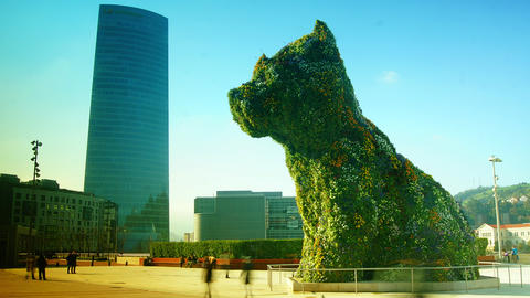 Bilbao Iberdrola Tower And Puppy Sculpture In Bilb Live Action
