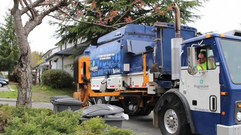New Garbage Truck Picks Up Trash Footage