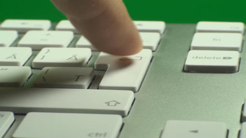 Hand Pressing The Enter Key On A Keyboard On A Gre Live Action
