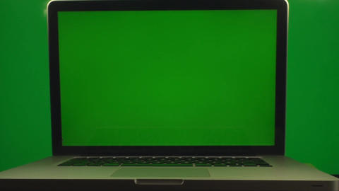 Opened Laptop On A Green Screen Background And A G stock footage