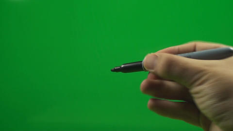 Man Opening A Marker And Then Drawing With It On A stock footage
