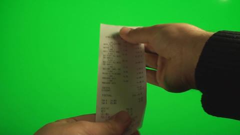 Hands Looking At A Receipt And Then Throwing It Aw stock footage