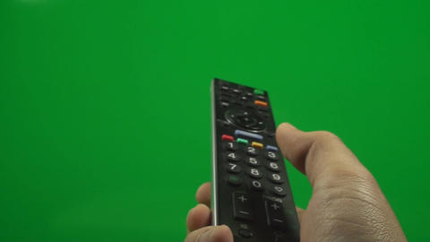 Television Remote On A Green Screen Pushing Volume Footage