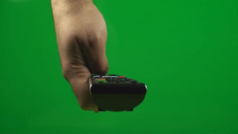 Television Remote On A Green Screen Pushing The Sw Footage