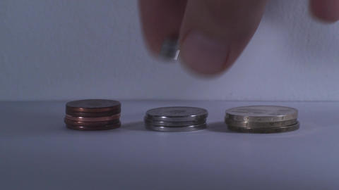 Man Hand Putting Some Coins Over A Stack Of Coins, Footage