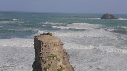 Wide Still Shot Of Murawai Ocean Rock Formation An stock footage
