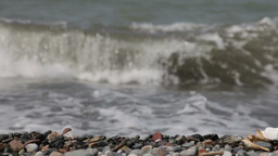 Sea waves on the rocky beach, changing focus Footage