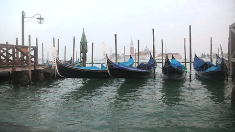 Gondolas In Venice At The Pier And View San Giorgi stock footage