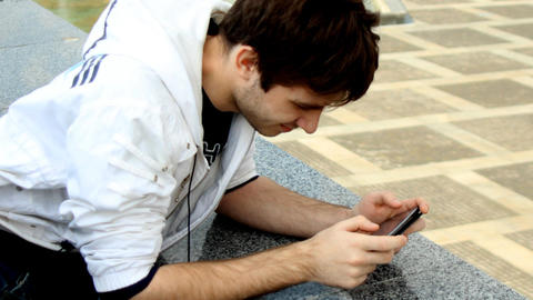 Young man using smartphone ビデオ
