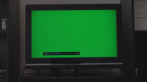 Turning Down The Volume On A HDTV With A Green Scr Footage
