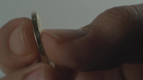 Extreme Close Up Of A Hand Holding A Coin, Currenc stock footage
