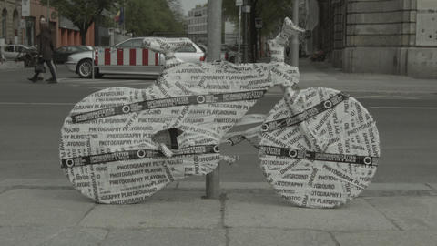 bike in Berlin covered in paper and plastic Footage