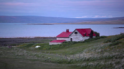 Remote house overlooking the coast in Iceland Footage