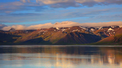 mountains reflecting in a lake in Iceland Footage