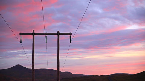 Mountains at sunrise with electric and telephone c Footage