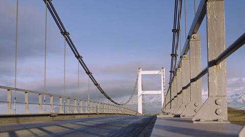 Road leading over a suspension bridge Live Action