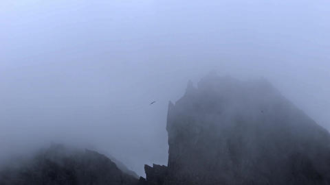 Rugged mountain peaks in mist in Iceland Live Action