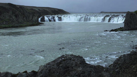 Waterfall in Iceland under a threatening sky Footage