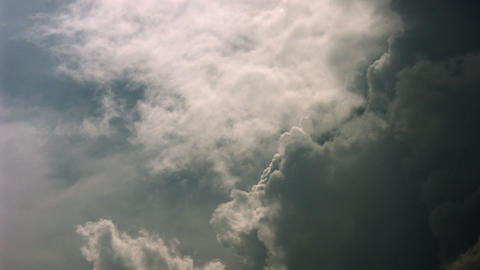Timelapse criss-crossing clouds Live Action