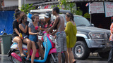 Young Women on a Motorbike Getting Mobbed During a Footage