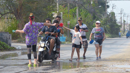 Motorcyclists Getting Splashed During Songkran Fes Footage