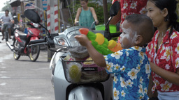Young Boy Shooting Water Pistol in Songkran Festiv Footage