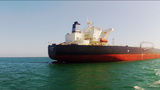 POV Boat Moving Toward Petro Chemical Ship In Long stock footage
