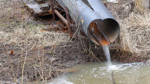 dirty water to the river on industrial from a pipe Footage