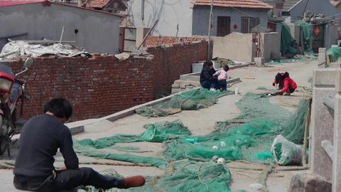 Fishermen repair nets Animation