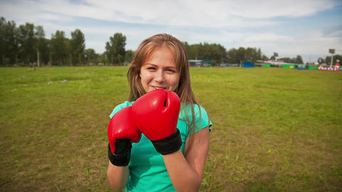 The Girl in Boxing Gloves in a Meadow Footage