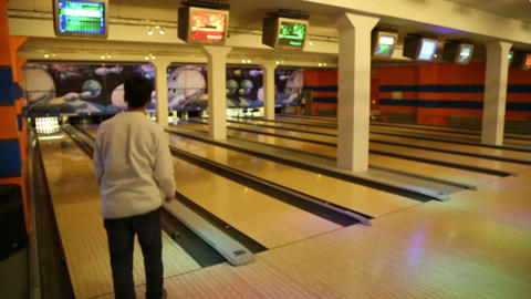 bowling - man rolls the ball and knocks down pins Footage