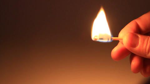 Man Lights A Match In Darkness stock footage