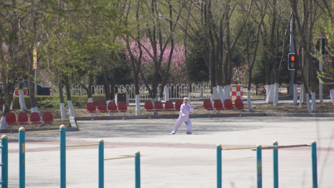 Chinese woman performs Taijiquan exercises Footage