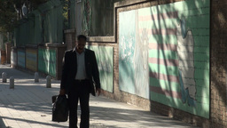Tehran, Man Walks Past Former US Embassy Compound stock footage